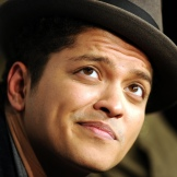 Singer Bruno Mars poses in the press room at the Grammy Nominations Concert, December 1, 2010 at Club Nokia in downtown Los Angeles. The 53rd annual Grammy Awards show will take place in Los Angeles on February 13, 2011. AFP PHOTO GABRIEL BOUYS (Photo credit should read GABRIEL BOUYS/AFP/Getty Images)