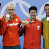 Singapore's Joseph Schooling takes gold over a remarkable three-way tie for silver between USA's Michael Phelps, Lészló Cseh of Hungary, and Chad le Clos of South Africa in 100m butterfly in Rio 2016.