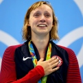 An Emotional Katie Ledecky celebrates on the podium after winning gold in the 800m freestyle, and lowering her own world record at the Rio 2016 Olympic Games.