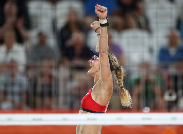 Kerri Walsh Jennings celebrates winning a point during a women's beach volleyball match against Australia at the 2016 Summer Olympics in Rio de Janeiro, Brazil, Sunday, Aug. 7, 2016. (AP Photo/Petr David Josek)
