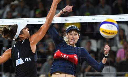Aug 12, 2016; Rio de Janeiro, Brazil; Kerri Walsh Jennings (USA) gets the ball past Laura Giombini (ITA) in a women's beach volleyball round of 16 match at Beach Volleyball Arena. Mandatory Credit: Jack Gruber-USA TODAY Sports