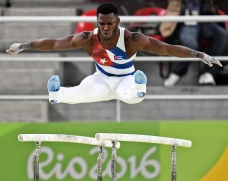 Manrique Larduet on the parallel bars at the Rio 2016 Olympics.