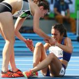 """The true Olympic spirit shone out when New Zealand's Nikki Hamblin (left) and Abbey D""""Agostino of the USA helped each other out after colliding in their heat of the women's 5000m. D'Agostino tore her anterior cruciate knee ligament in the incident but both runners insisted on completing their race. They were both handed places in the final but the injury prevented the American taking part. Photo Credit: BBC"""