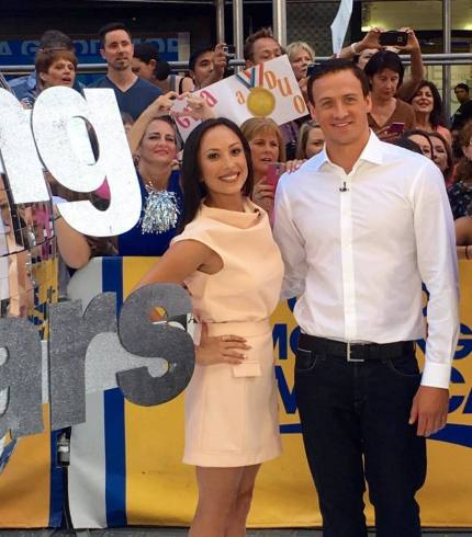 Ryan Lochte & Cheryl Burke posing for fans at GMA reveal of season 23 Dancing With The Stars.