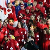 Team Canada, waving goodbye to Rio at the closing ceremony, clad in maple-leaf mittens.