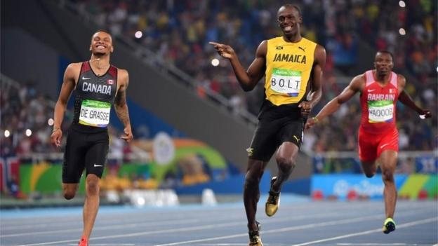 Usain Bolt and Andre De Grasse finishing men's 200m semi-final