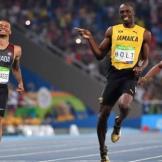 Unperturbed Bolt, once again, shows his gregarious personality by pointing in admiration at Canada's Andre De Grasse as both men cross the line - in first and second place respectively - in the men's 200m semi-final. Bolt went on to win the final, of course. Photo Credit: BBC
